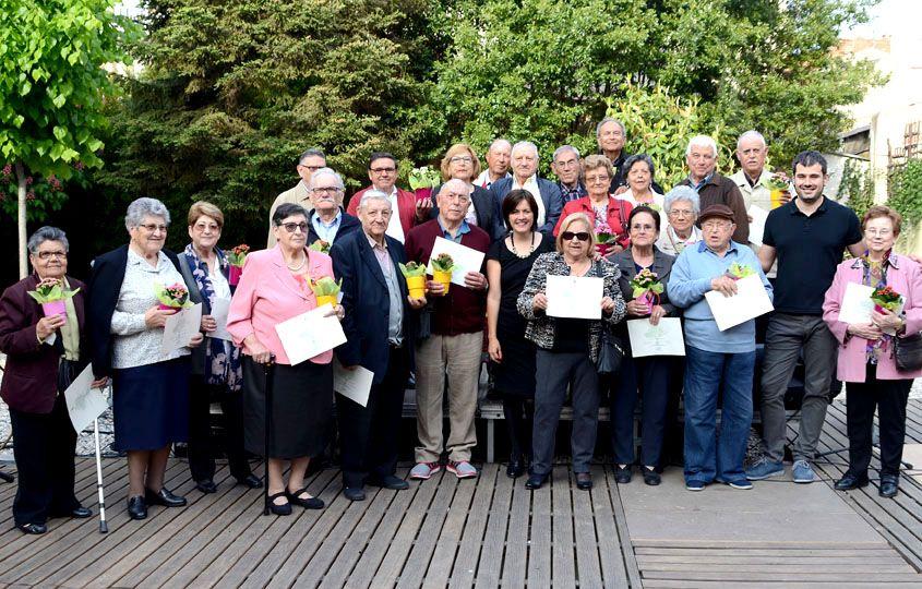 Foto de família de les persones participants a l'acte